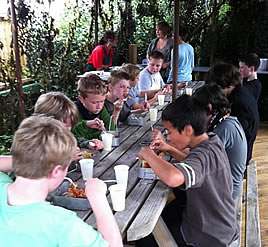 children enjoying a meal after a laser game party